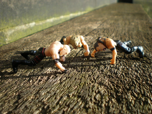 WWE wrestlers doing push ups