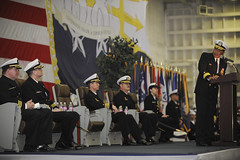 Rear Adm. Peter A. Gumataotao, commander of Carrier Strike Group 11, addresses Capt. Paul O. Monger and Capt. Jeffery S. Ruth during the change of command ceremony aboard the aircraft carrier USS Nimitz (CVN 68) Feb. 11.