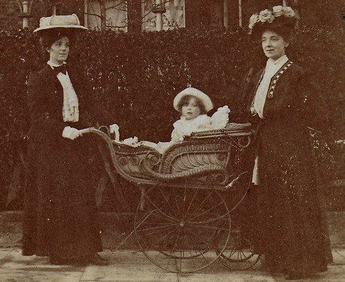Two ladies and a baby in a wicker pram. (enlarged detail)