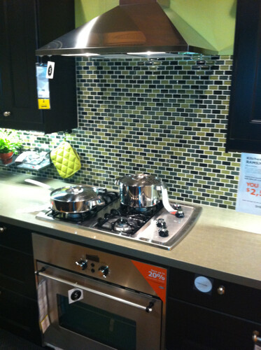 cjinteriors posted a photo:	Love the glass mosaic subway tiles used on the backsplash behind the stove