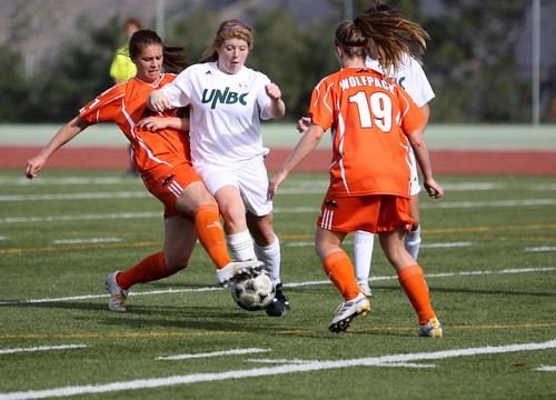 Laura Smylie and Emily Oliver defend vs UNBC (horizontal Oct 9, 2011 Douglas Sage)