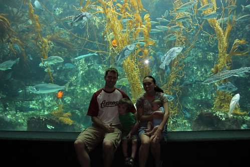 Family picture in front of the large aquarium