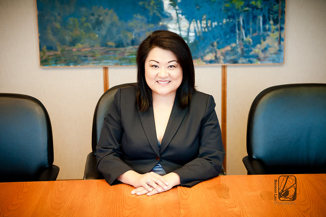 An executive in the conference room posing for her corporate headshot in Richmond, Virginia. Taken by Benson Lau Photography