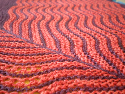 Ripple knitting in orange and purple