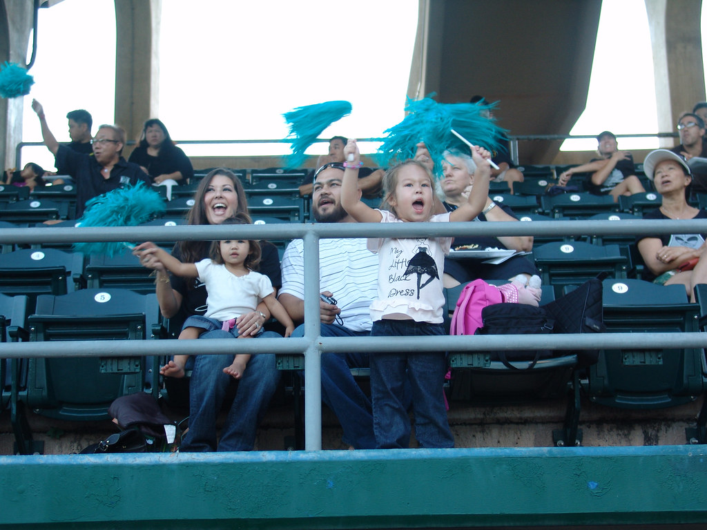 <p>Young fans cheered for the Honolulu  Dillinghammas at the UH AUW Softball Tourment at Les Murakami Stadium on Sept. 30, 2011</p>