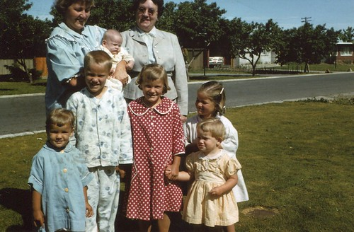 Aunt Marcine holding Scott with Grandma Price kids in front: Nancy, Terry, Bonnie, Janet and Ruth