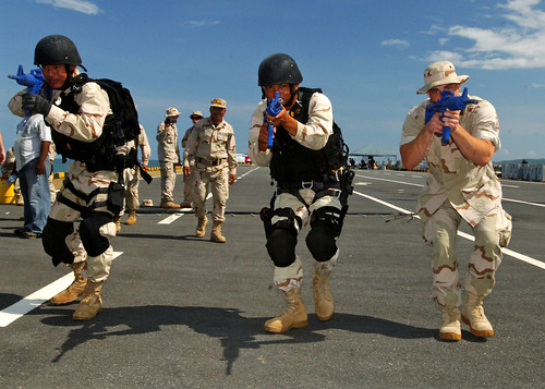 Royal Cambodian Navy Sailors practice tactical entry maneuvers during visit, board, search and seizure training