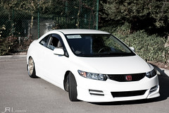honda civic type r(0.0), automobile(1.0), automotive exterior(1.0), wheel(1.0), vehicle(1.0), automotive design(1.0), rim(1.0), honda(1.0), compact car(1.0), bumper(1.0), honda civic hybrid(1.0), sedan(1.0), land vehicle(1.0), honda civic(1.0), sports car(1.0),