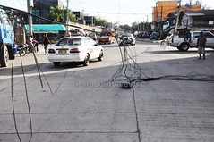 Which utility firm owns this jumble of wires that have fallen on Arellano Street near Pier 2 in Cebu City? They need to be fixed soon.