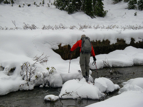 Definately a tricky part of an early season ski is finding a way across creeks. Here Tristen works his way across with dry feet, and mostly dry skins.