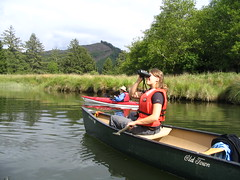 Families bird watching by canoe in Siletz Bay NWR