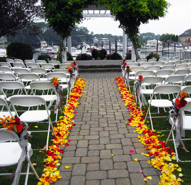 Outdoor Wedding Aisle in Yellow and Red Rose Petals