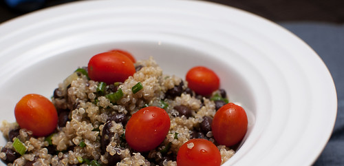 Quinoa with tomatoes, black beans and scallions