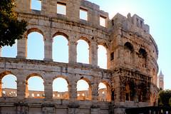 aqueduct(0.0), palace(0.0), triumphal arch(0.0), amphitheatre(1.0), ancient roman architecture(1.0), arch(1.0), ancient history(1.0), historic site(1.0), tourism(1.0), landmark(1.0), architecture(1.0), history(1.0), ruins(1.0), ancient rome(1.0),