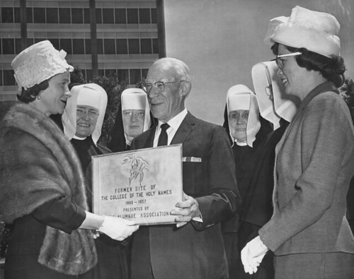 Alumni and Sisters present a plaque to Mr. Henry Kaiser, 1957