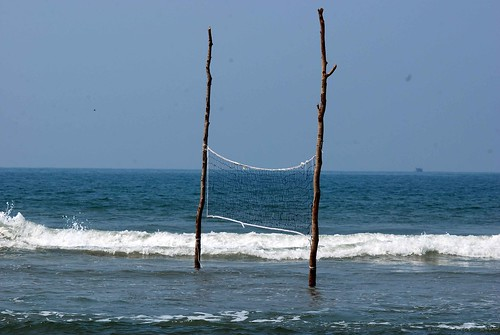 Volleyball in the water: rising sea levels, Morjim, Goa.