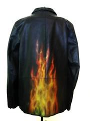 orange(1.0), textile(1.0), leather jacket(1.0), clothing(1.0), sleeve(1.0), leather(1.0), outerwear(1.0), jacket(1.0),