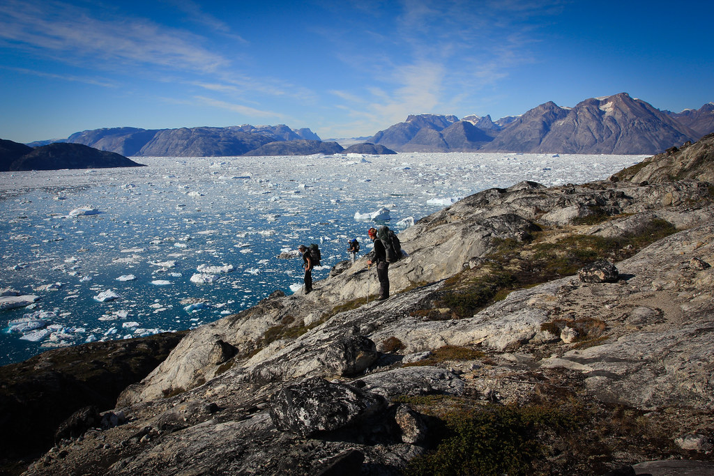 Climb up some slabs to bypass a rock band on the coast. Sermilik. East-Greenland.