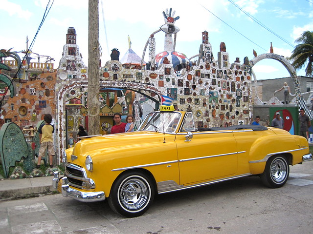 classic car in front of cuban artist - home - tour