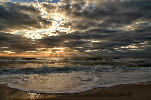 ocean clouds sunrise newjersey waves nj lbi longbeachisland atlanticocean hdr crepuscularrays spraybeach