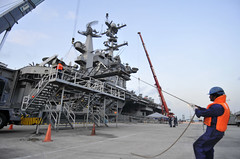 SINGAPORE (Oct. 16, 2011) Contractors lift the brow from USS George Washington (CVN 73) prior to the ship getting underway from Changi Naval Base in Singapore. (U.S. Navy photo by Mass Communication Specialist 3rd Class Jacob D. Moore)