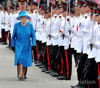The Queen inspects the Guard of Honour during a visit to the Australian Royal Military College