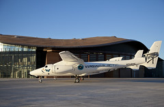 SpaceShipTwo and mothership, WhiteKnightTwo stand before their new home, VG Gateway to Space. Photo by Mark Greenberg