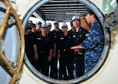 POLARIS POINT, Guam (Nov. 7, 2011) Navy Diver 2nd Class John Miranda, assigned to the submarine tender USS Frank Cable (AS 40), shows the ship's recompression chamber to sailors from the Republic of Korea navy submarine ROKS Park Wi (SS 065). (U.S. Navy photo by Mass Communication Specialist 2nd Class Jeremy Starr)