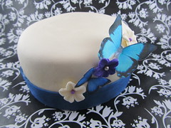 Butterflies and Flowers on an ivory top cake
