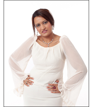 Makeovers and Photo Shoot, woman poses in cream dress for a lovely high key image photographed against a white background.