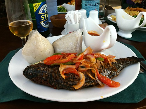 Grilled whole fish with mild and hot peppers
