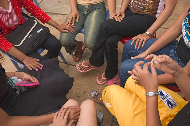 Sex workers, Cambodia. Sex workers learn how to use condoms.