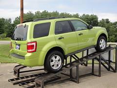 automobile(1.0), automotive exterior(1.0), sport utility vehicle(1.0), mini sport utility vehicle(1.0), wheel(1.0), vehicle(1.0), compact sport utility vehicle(1.0), rim(1.0), crossover suv(1.0), ford escape(1.0), bumper(1.0), ford escape hybrid(1.0), ford(1.0), land vehicle(1.0),