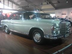 sedan(0.0), sports car(0.0), automobile(1.0), automotive exterior(1.0), vehicle(1.0), mercedes-benz w108(1.0), mercedes-benz(1.0), compact car(1.0), antique car(1.0), classic car(1.0), land vehicle(1.0), luxury vehicle(1.0), convertible(1.0),