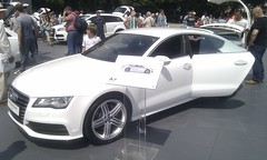 automobile(1.0), audi(1.0), exhibition(1.0), executive car(1.0), audi a7(1.0), family car(1.0), wheel(1.0), vehicle(1.0), automotive design(1.0), auto show(1.0), audi sportback concept(1.0), sedan(1.0), land vehicle(1.0), luxury vehicle(1.0),