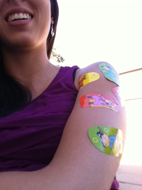 Allison with a bunch of stickers on her arm