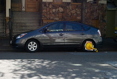hatchback(0.0), automobile(1.0), automotive exterior(1.0), wheel(1.0), vehicle(1.0), compact car(1.0), toyota prius(1.0), land vehicle(1.0),