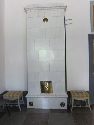 A white fireplace, ground floor