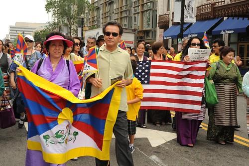 Tibetan and American Flags, Tibetan Association of Southern California, marching in solidarity for peace, women wearing chubas, Happy Birthday to His Holiness the Dalai Lama Parade, Tibetans at Kalachakra, Washington D.C., USA by Wonderlane