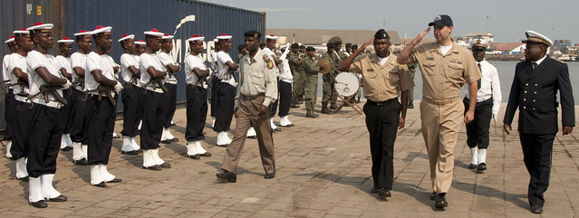 Sailors salute members of the Congolese military during a welcoming ceremony for Africa Partnership Station 2011
