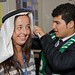 Estelle Simon gets some assistance trying out Saudi Arabian headgear.