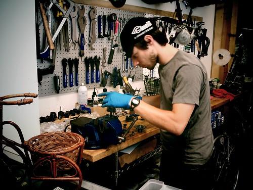 Jon from Flying Pigeon LA bike shop working on an old hub