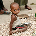 Baby Boy Sitting on Garlic - Hatiandha, Bangladesh