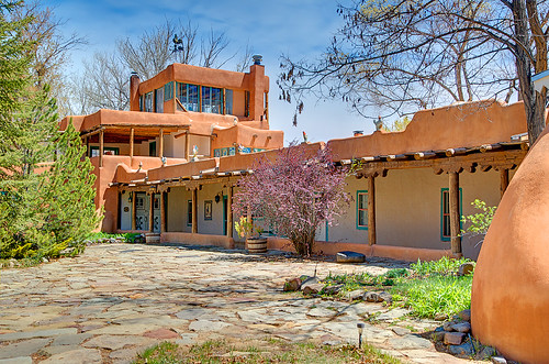 Mabel' courtyard.--- In 1919 Mabel Dodge Sterne moved to Taos, New Mexico and started a literary colony there. Today as you approach the house of Mabel Dodge Luhan, it's easy to see why some of the greatest minds of the 20th century were inspired here. Situated at the end of a quiet road not far from the center of town, the house appears much as it did in the days when Mabel admired her views of the sacred Taos Mountain from the third-story solarium. One can only imagine the tantalizing conversations that must have taken place within these walls. After all, Georgia OKeeffe stayed here. So did D.H. Lawrence, Ansel Adams, Martha Graham and Carl Jung, among many other notables. As an historic inn and conference center which offers retreat-style meetings and artistic, literary, and personal growth workshops, the Mabel Dodge Luhan House continues to build on its 80-year history of personal, intellectual and artistic ferment. Dennis Hopper wrote the script for Easy Rider at the house Hopper ensconced himself at the Mabel Dodge Luhan House in Taos, New Mexico, which he then purchased in 1970.