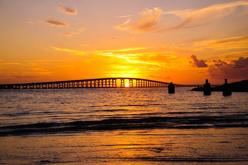 bridge sunset orange seascape skyline explore outerbanks obx waterbirds outdoorphotography northcarolinaphotography stephanherzogphotography