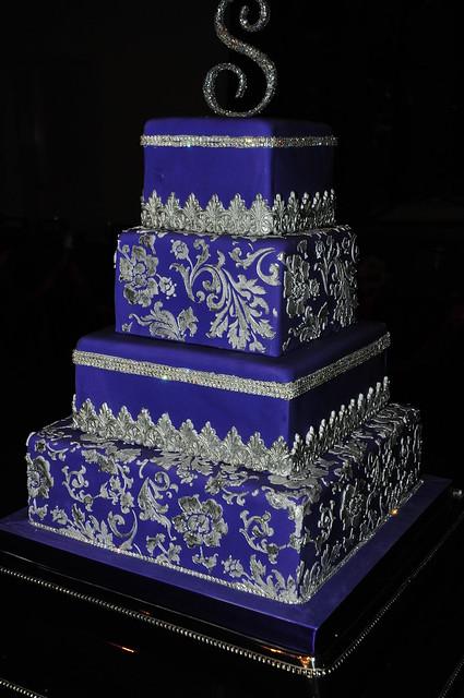 Royal purple fondant wedding cake with royal icing stencil fondant