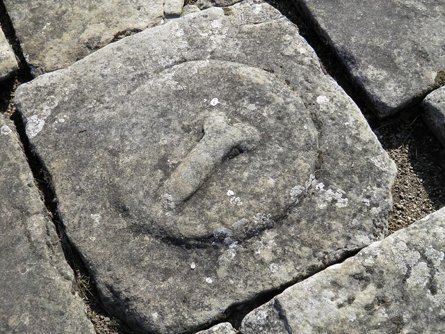 Phallic symbol carved in paving stone, The Headquarters Building, Chesters Roman Fort