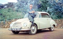austin fx4(0.0), mid-size car(0.0), morris minor(0.0), automobile(1.0), vehicle(1.0), subcompact car(1.0), dkw 3=6(1.0), compact car(1.0), antique car(1.0), sedan(1.0), vintage car(1.0), land vehicle(1.0),