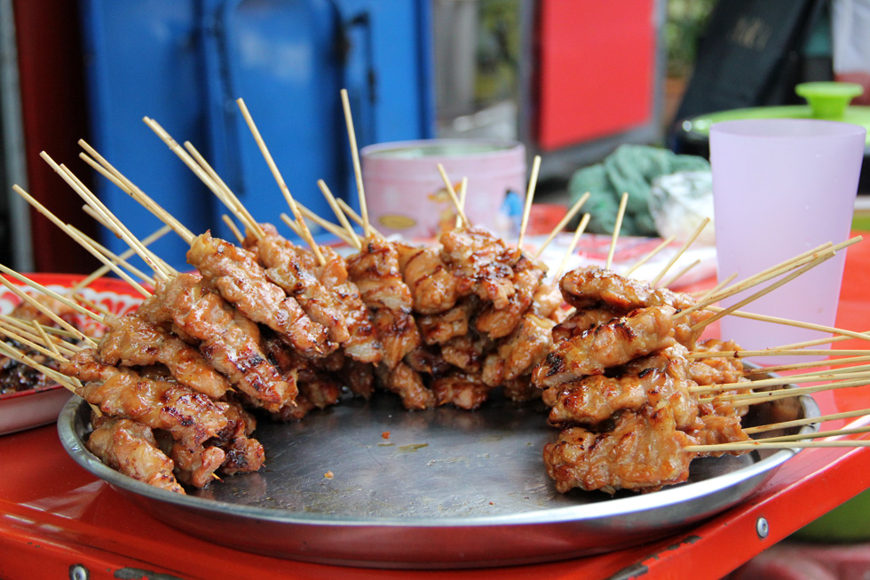 Platter of thai style grilled pork sticks moo ping for At home thai cuisine