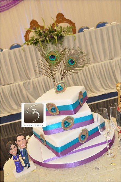 We have done lots of variations of Peacock wedding cakes for 2011